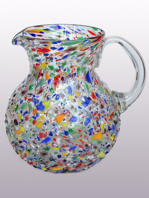 Wholesale Confetti Glassware / 'Confetti rocks' blown glass pitcher / Confetti rocks appear to rest inside this modern blown glass pitcher that will make your table setting shine. Each pitcher is adorned with hundreds of tiny multicolor glass particles, giving it a one-of-a-kind look and feel.